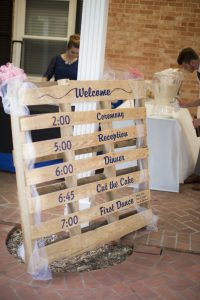 Vinyl Signs and Vinyl Lettering on a Palette showing Store Hours by Embroider It in Columbia MO web